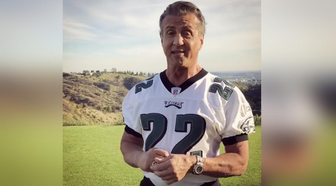 Sylvester Stallone wearing Philadelphia Eagles Football Jersey