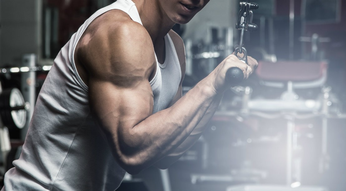 Man Performing Triceps Pushdown At Gym