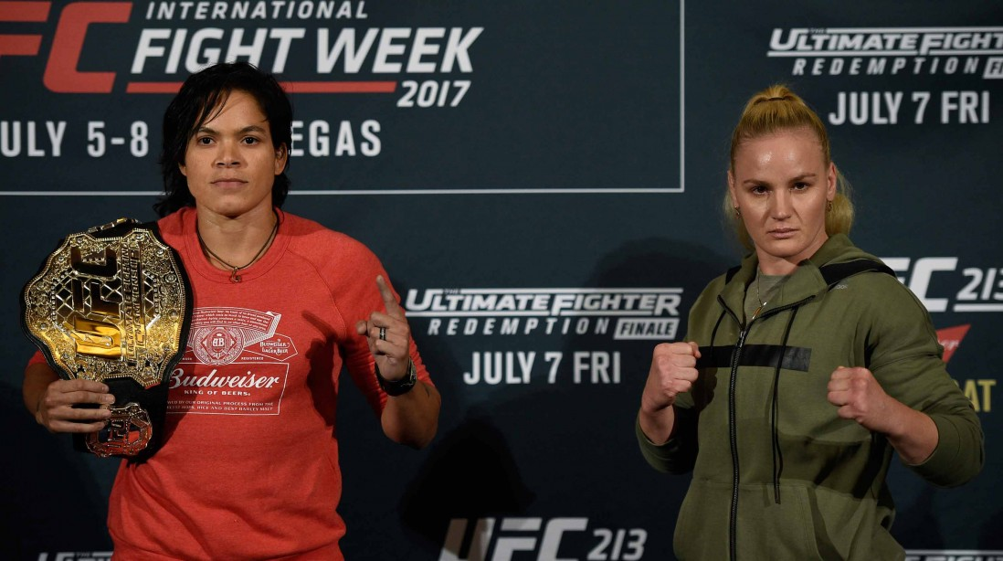 Amanda Nunes (L), UFC bantamweight champion, poses with her belt as she faces face off with challenger Valentina Shevchenko