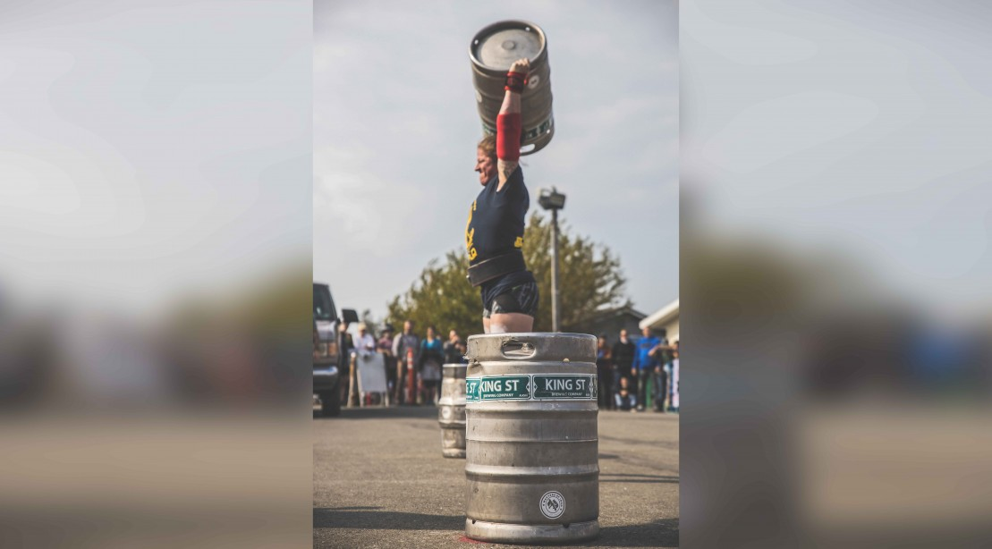 Danielle Vaji presses a keg at the Strongest Women in the World competition
