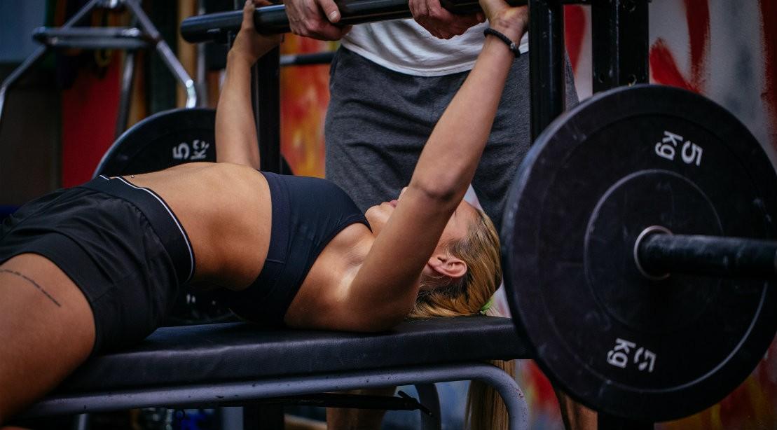 Woman lifting weights at gym