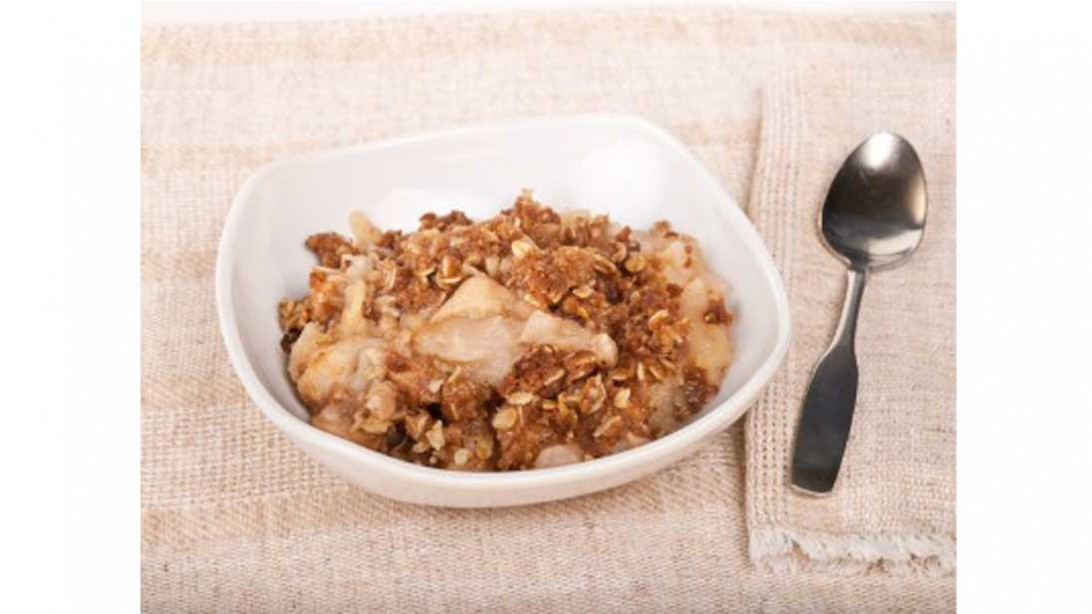 bowl of apple crisp with spoon