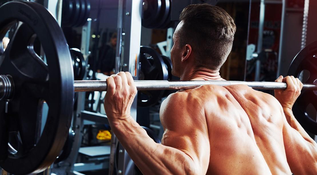 Man Does Back Squat Exercise