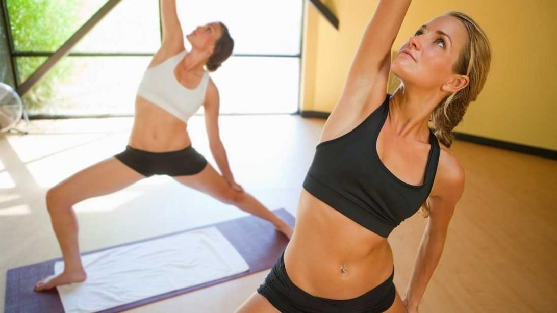 two women doing yoga poses