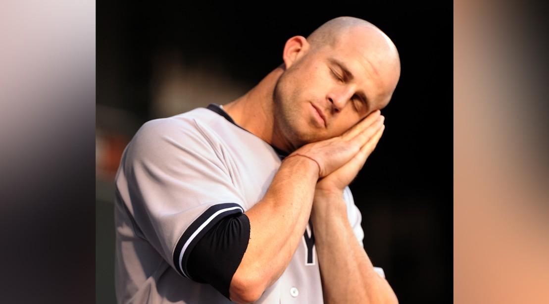 Brett Gardner #11 Of The New York Yankees Takes A Mock Nap