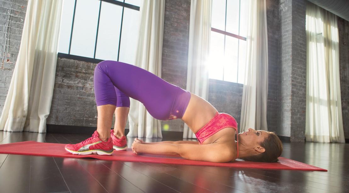Michelle Johnson Doing A Bridge Pose