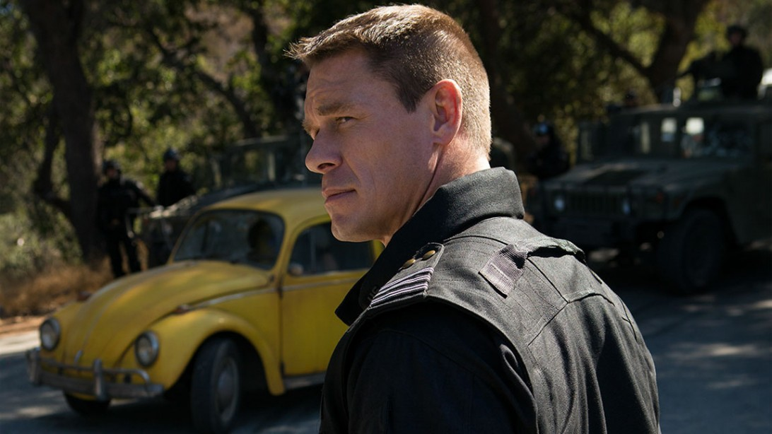 """John Cena Fights Transformers in New Action-Bumblebee Pendant """"title ="""" John Cena fights Transformers in the new, action-packed """"Bumblebee Trailer"""" />    <div class="""