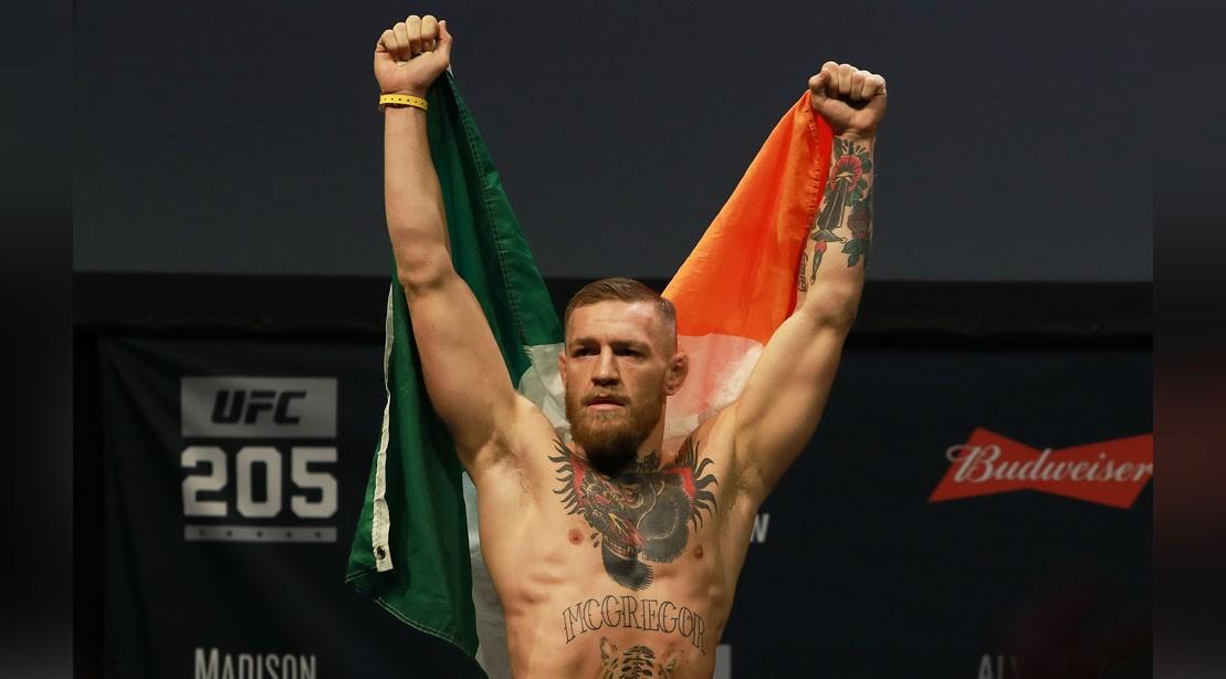 UFC Featherweight Champion Conor McGregor Reacts As He Walks On Stage For UFC 205