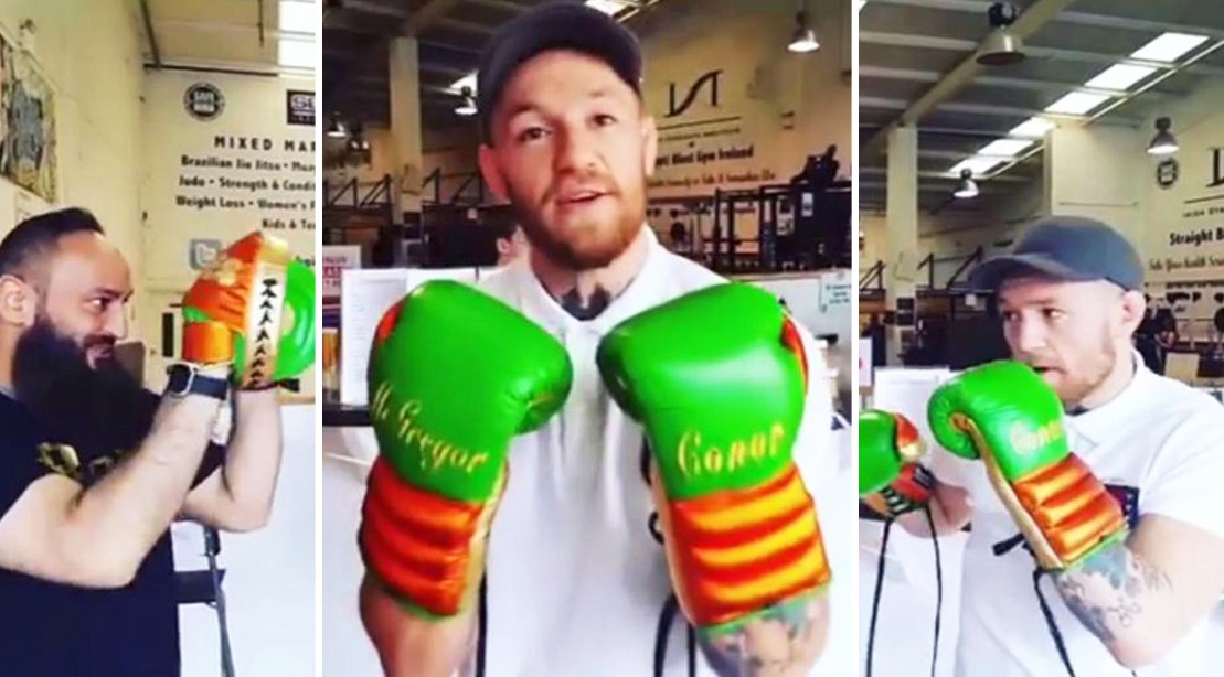 Conor McGregor boxing with Irish gloves.