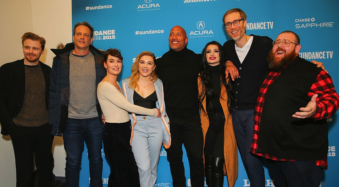 Actors Jack Lowden, Vince Vaughn, Lena Headey, Florence Pugh, Dwayne Johnson, Paige, executive producer Stephen Merchant, and actor Nick Frost pose for a photo at the special Sundance screening of 'Fighting with My Family' on January 28, 2019 in Park City