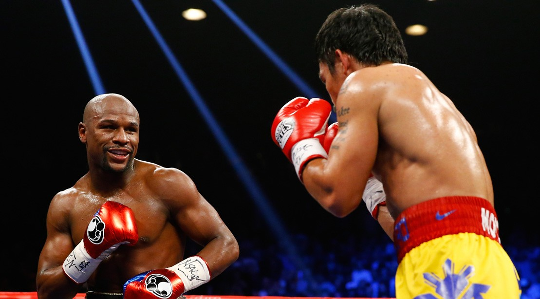 Floyd Mayweather Jr. Smiles At Manny Pacquiao
