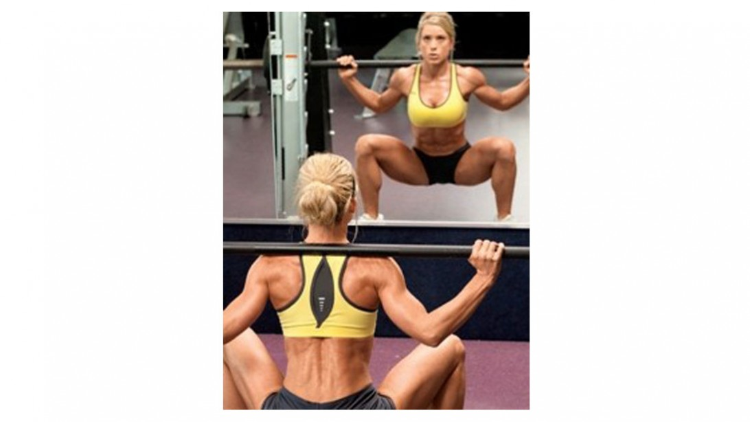 woman doing squatting exercise with barbell