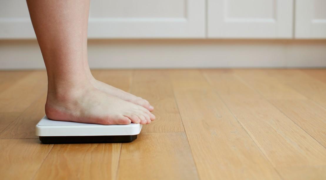 Woman Weighs Herself