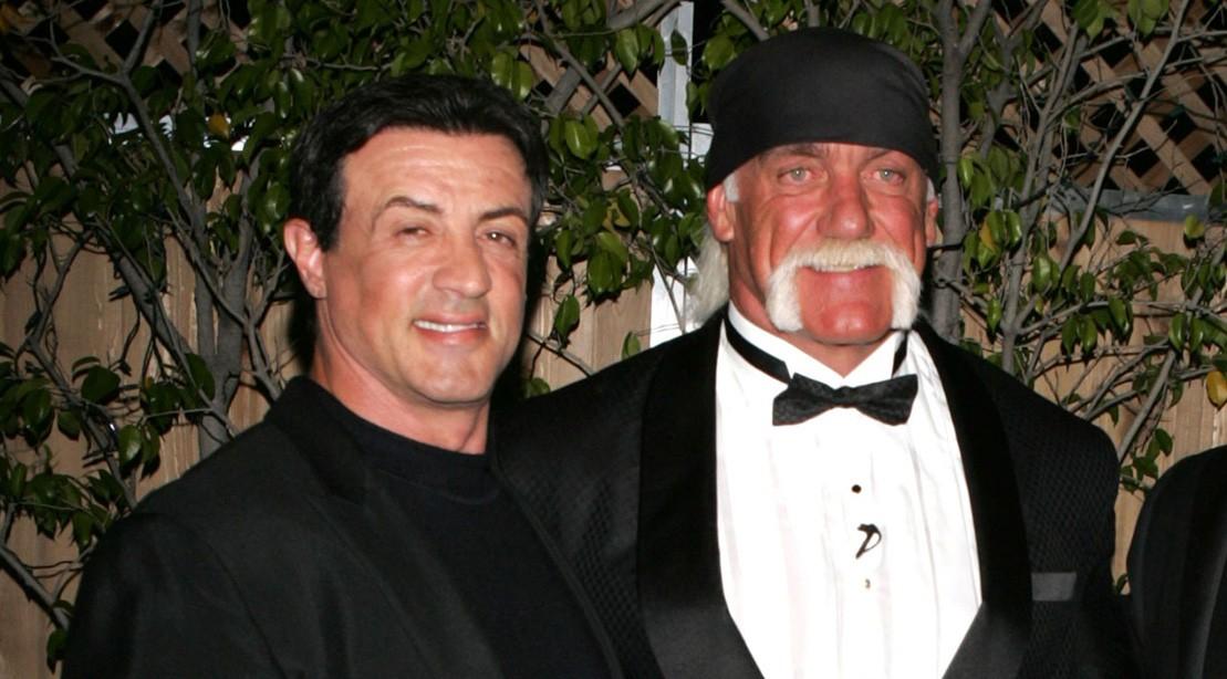 Hulk Hogan and Sylvester Stallone embrace.