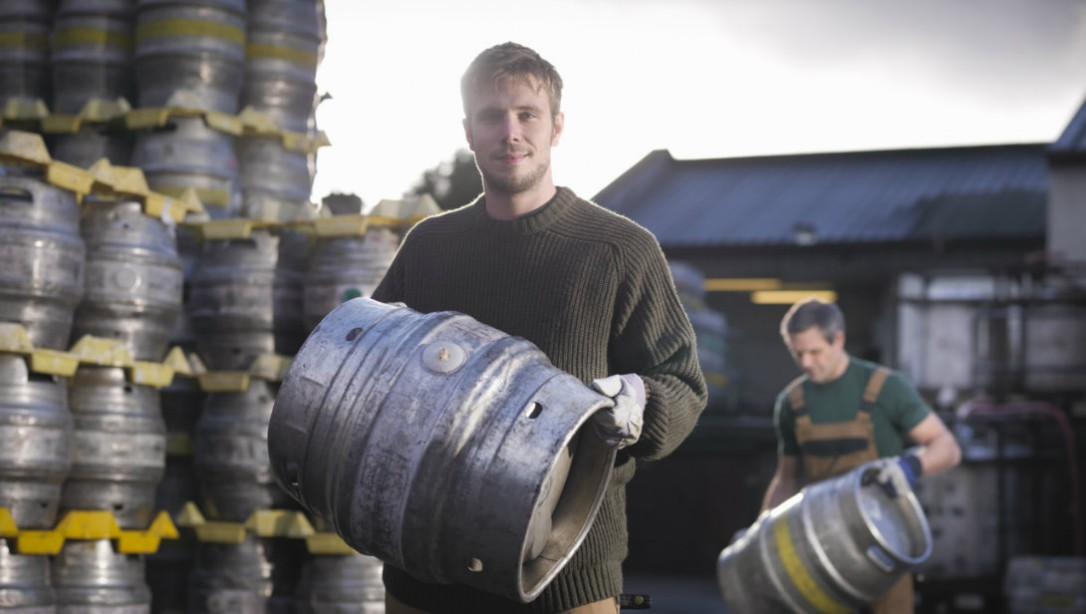 Man lifting beer keg