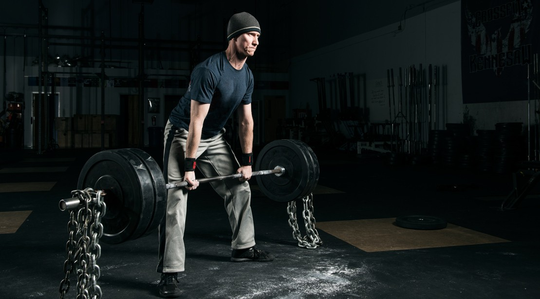 Man Lifting With Chains