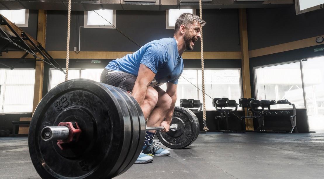 Man Deadlifts in Gym