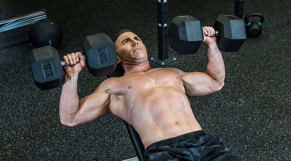 "Man Exercising - Dumbbell Bench Press ""title ="" Man Exercising - Dumbbell Bench Press ""/>   <div class="