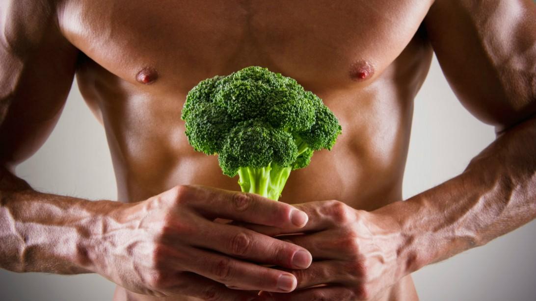 man holding broccoli stem