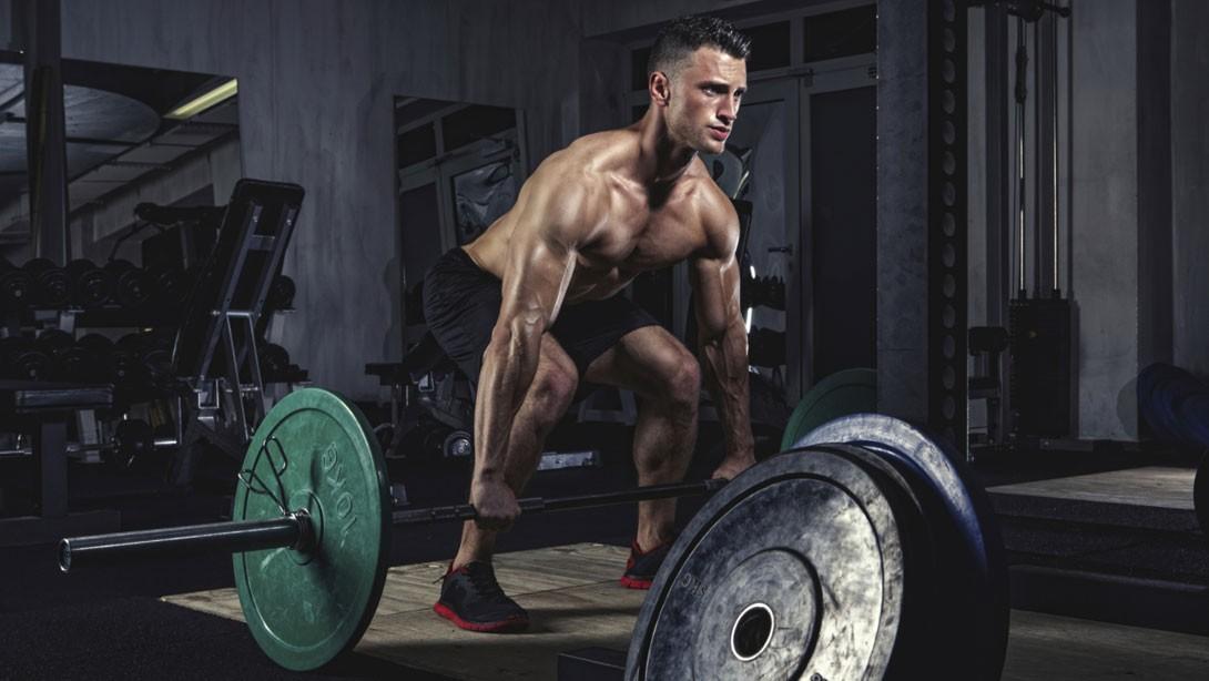 Man Performing Deadlift in Gym