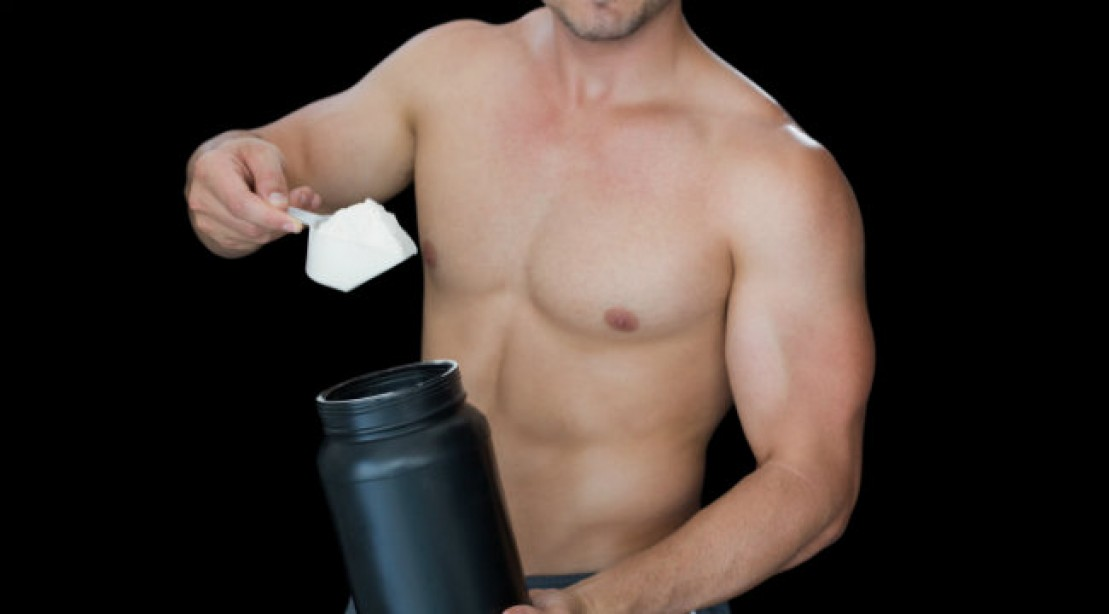man with protein powder supplement