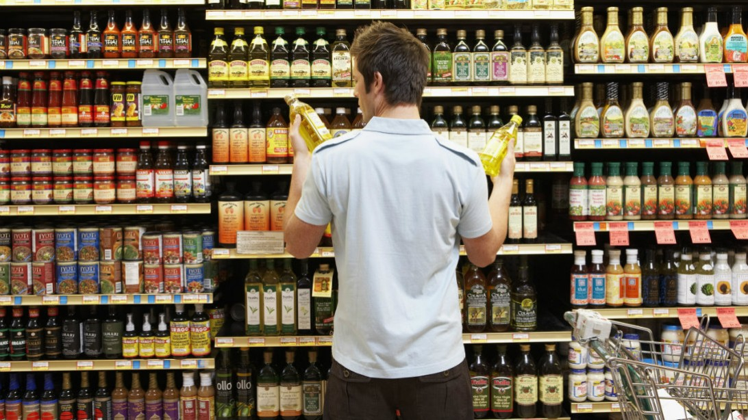 man reading food label