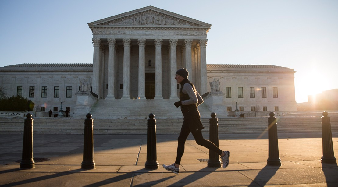 Man Running Outside The Supreme Court