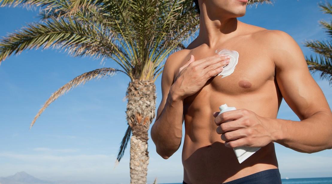 Man Applying Sunscreen