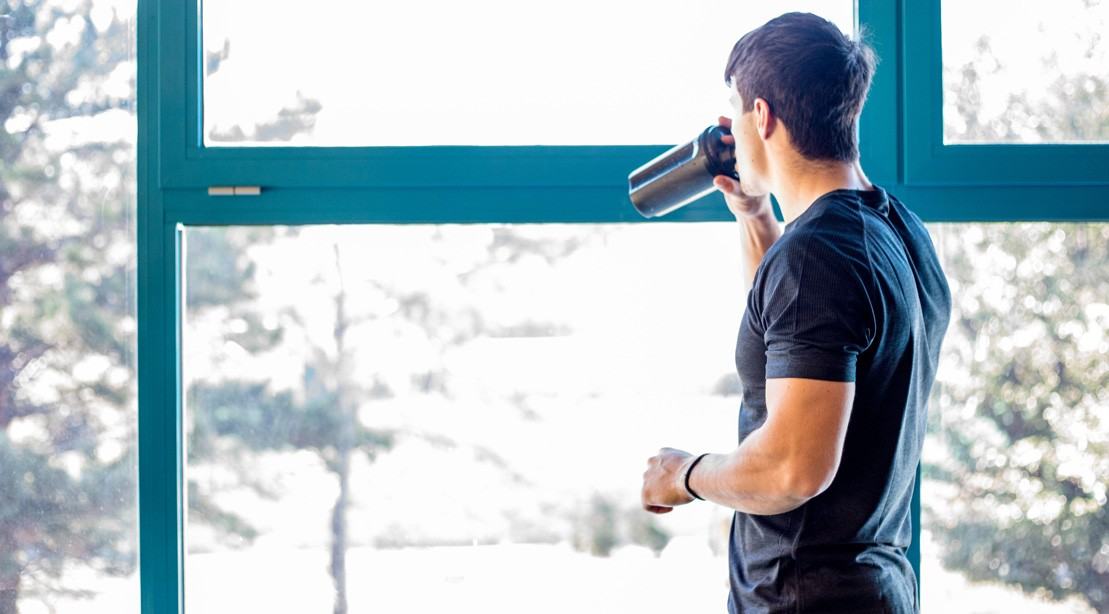 Man Drinking Workout Supplement