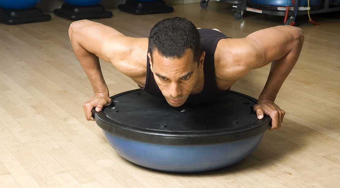 Man Using Bosu Ball