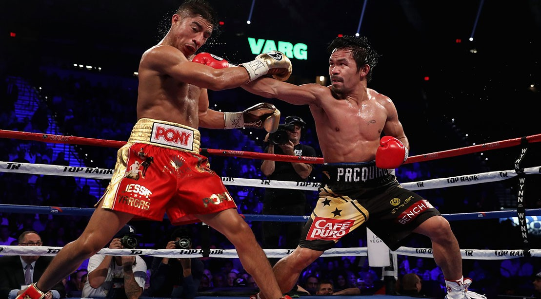 Manny Pacquiao (R) lands a right on Jessie Vargas during their WBO welterweight championship fight at the Thomas & Mack Center on November 5, 2016