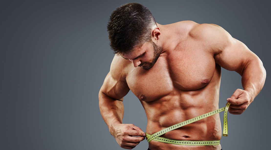 Muscular Man Measuring His Waist