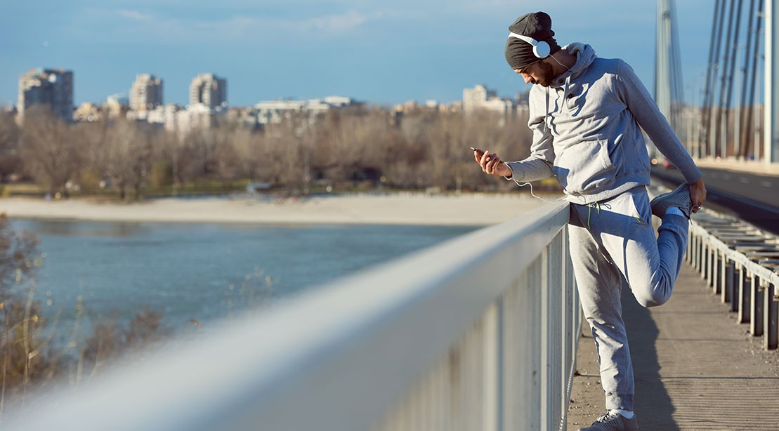 Man Exercising Outdoors On Phone