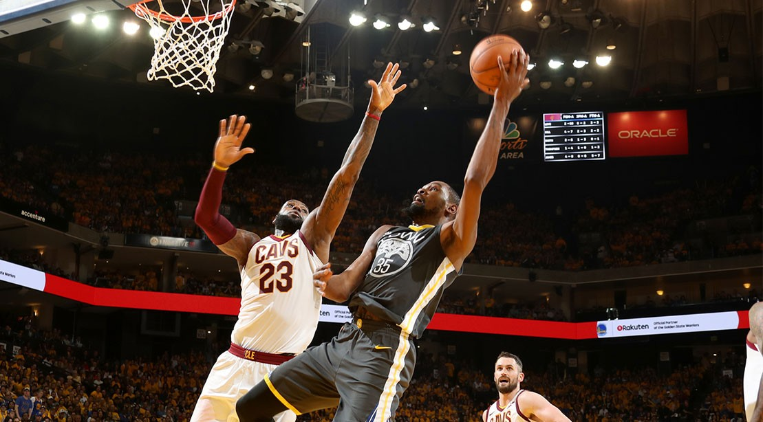 JUNE 3: LeBron James #23 of the Cleveland Cavaliers defends Kevin Durant #35 of the Golden State Warriors in Game Two of the 2018 NBA Finals on June 3, 2018 at ORACLE Arena in Oakland, California.