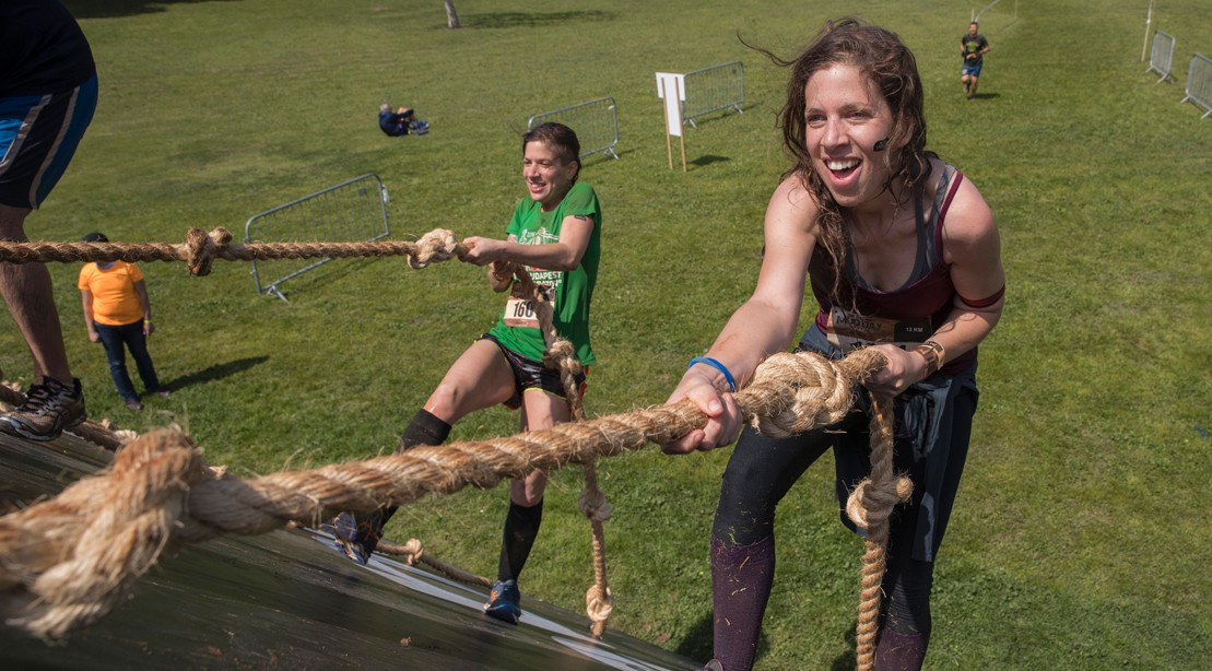 Participants Take Part In The Mud Day Race, A 13Km Obstacle Course