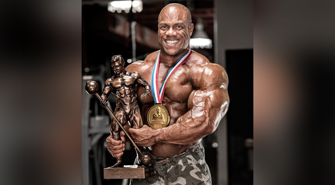 Phil Heath Holding Mr. Olympia Trophy