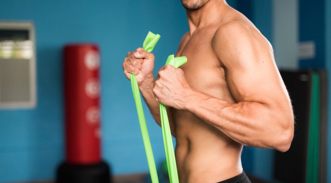 resistance band curl man GettyImages 670884157