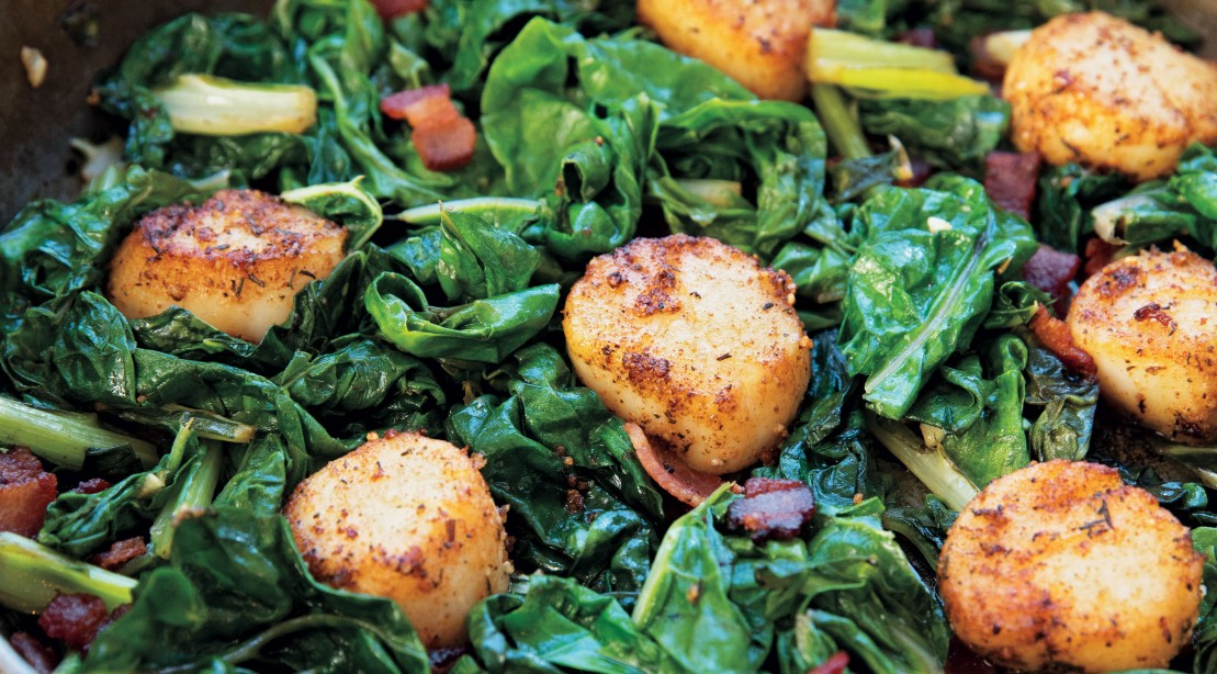 Pan-Seared Scallops with Bacon Over Braised Swiss Chard