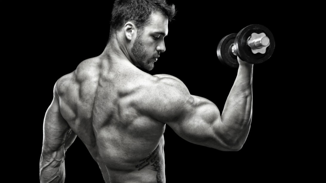 Two muscle men in public