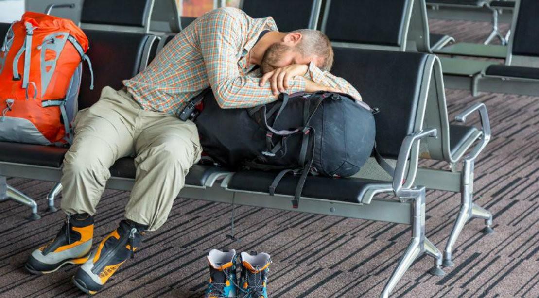 Man Sleeping At Airport