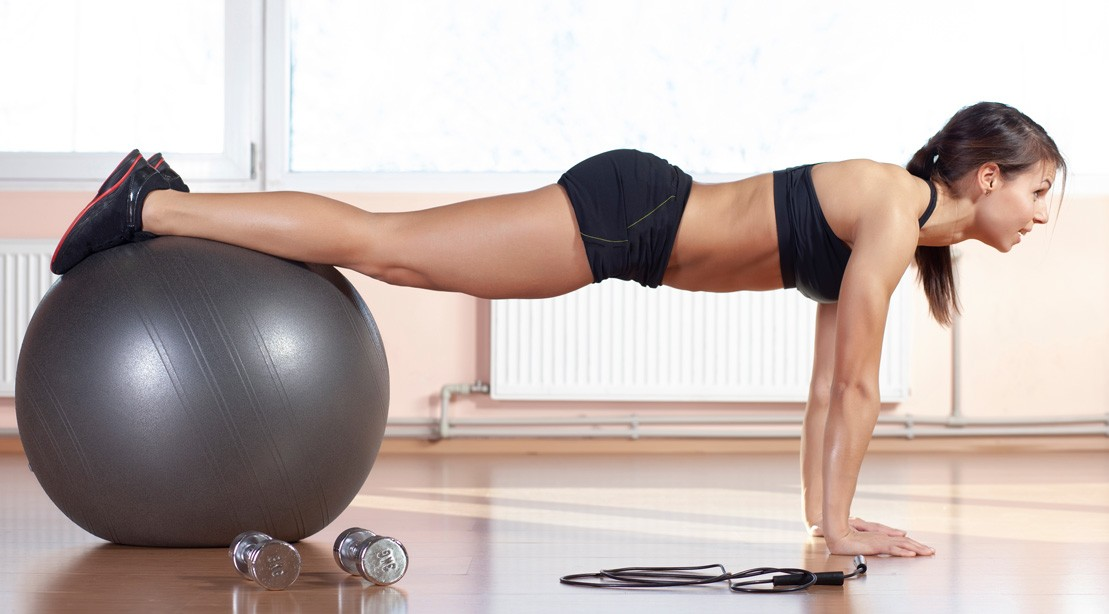 Woman Doing Stability Ball Exercise