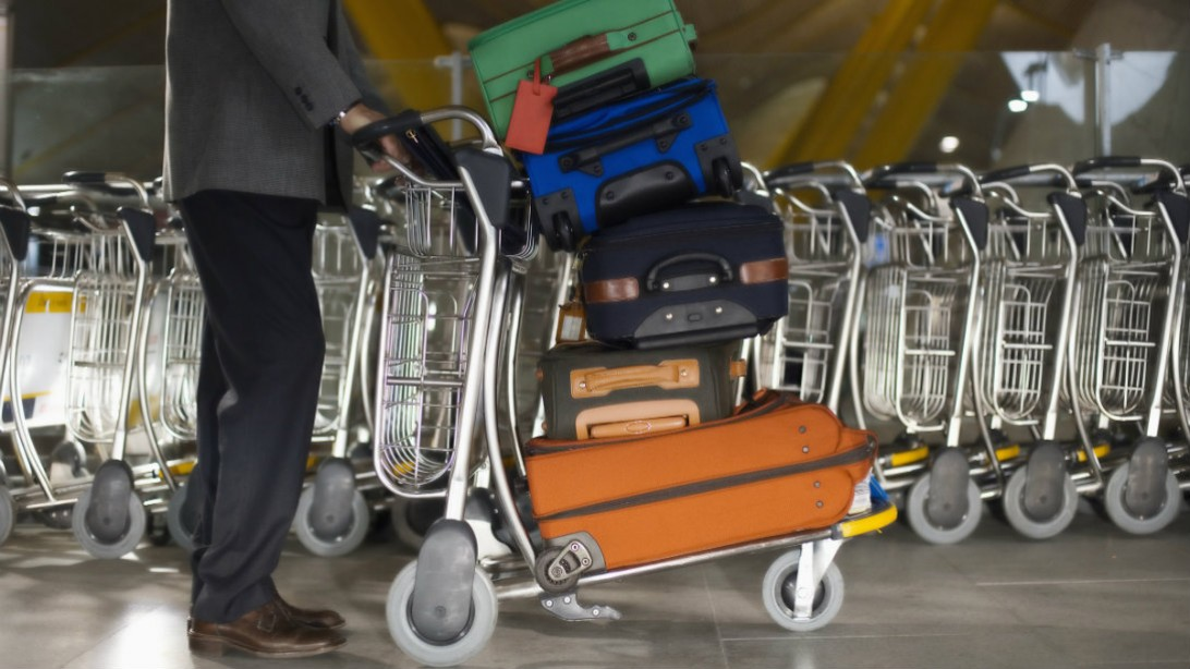 stacked luggage at airport