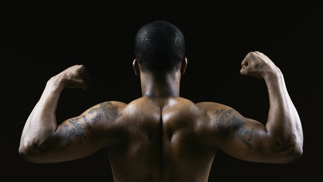 Man's muscular back big traps