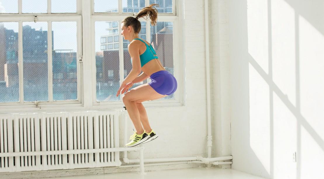 Woman Preforming A Tuck Jump