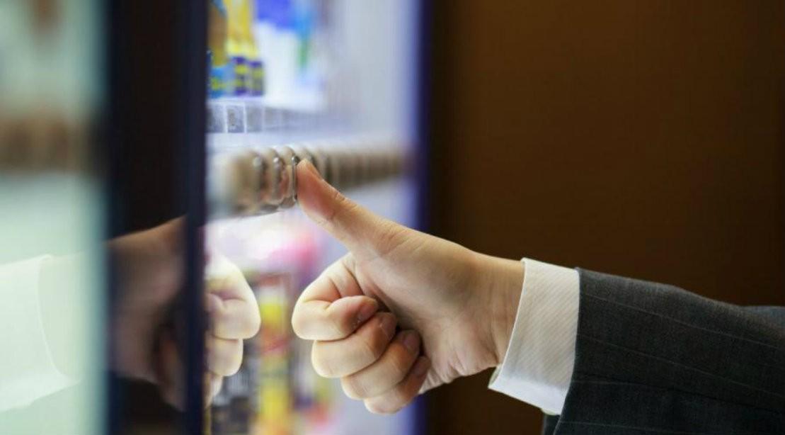 Man At Vending Machine