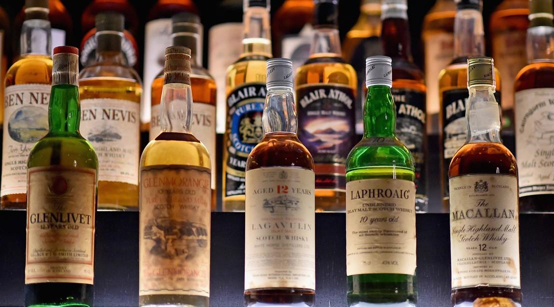 Whiskey bottles at a bar.
