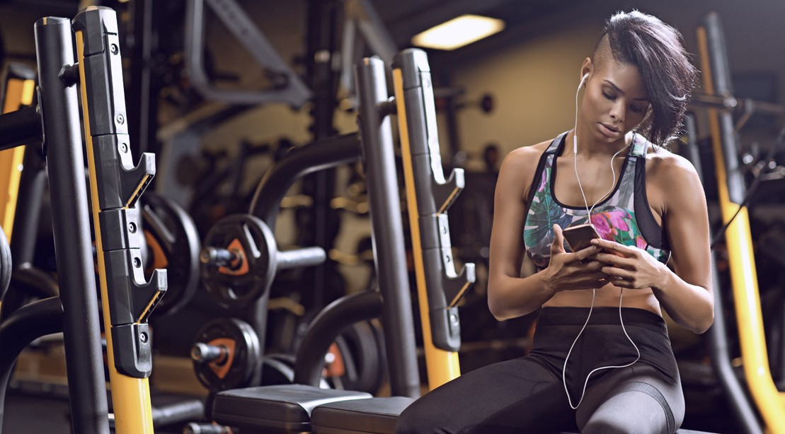 Woman On The Phone In The Gym