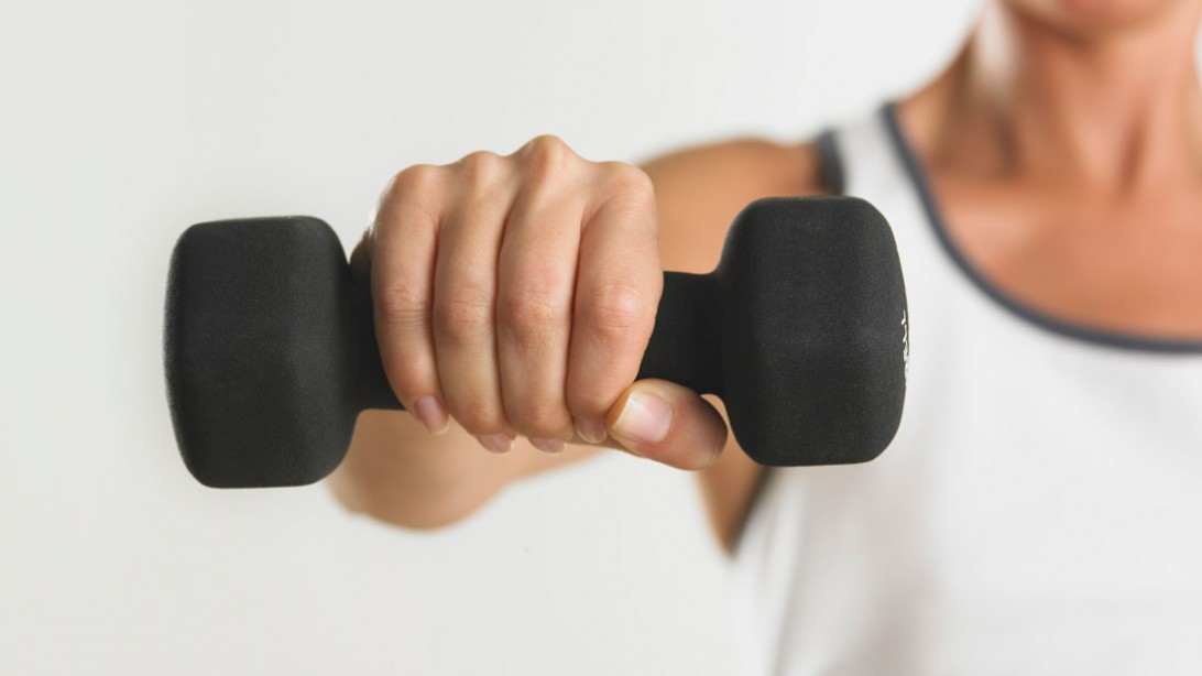 woman's arm lifting a weight