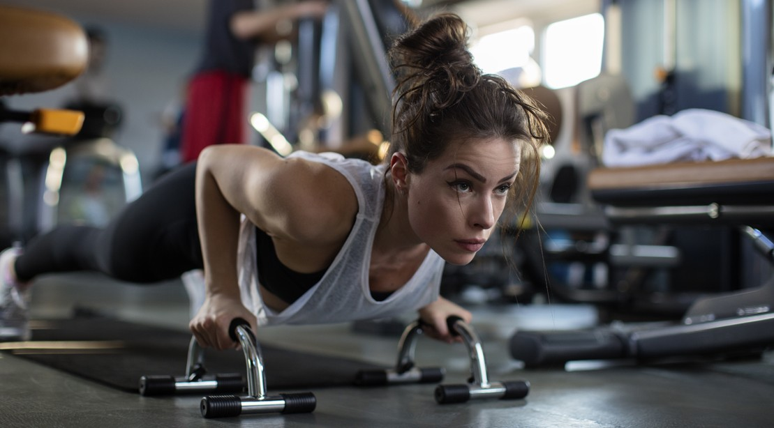 Brunette Working Out At A Gym