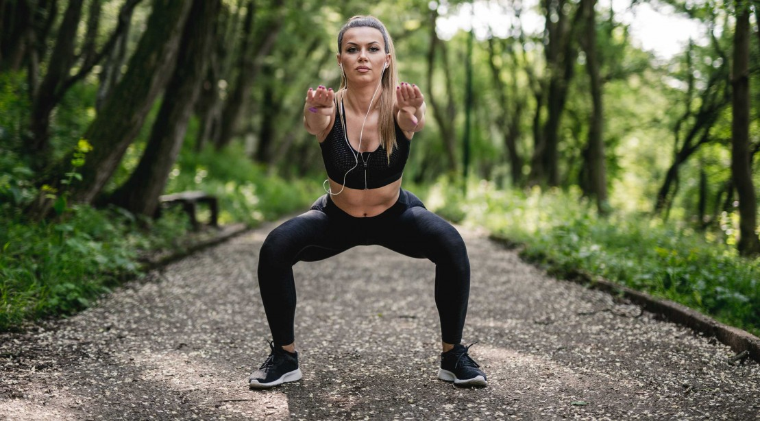 Woman Squatting Outdoors